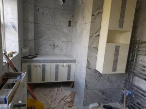 Tiles encrusted in bathroom cabinet